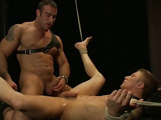 tattooed gay stud dominates and copulates tied