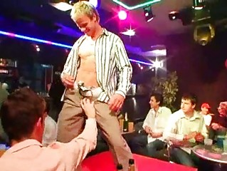 gay dudes doing striptease and acquiring banknotes