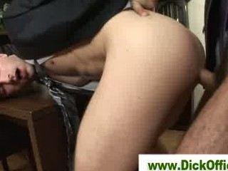 two gay businessmen piercing and licking