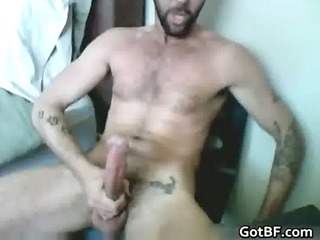 tattooed shaggy hunk pushing dildo gay sex