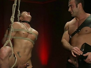 black haired gay hunk dominates over tied