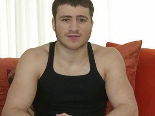 muscled gay stud exposing and pushing dildo into