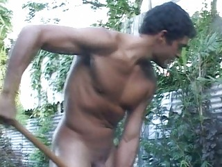 muscular gay fellow works into the garden nude