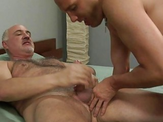 ancient gay gives fresher hunk a handjob on bed