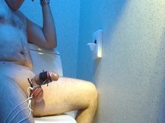 estim on a outdoor toilet, large cumshot