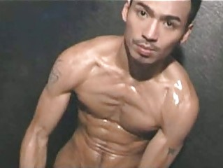 eastern  muscled gay male with lotion
