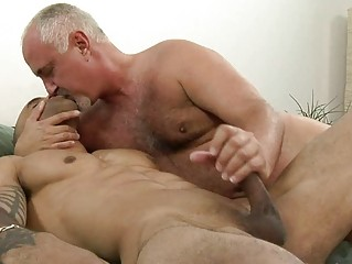 sweet tattooed gay giving handjob to his mature