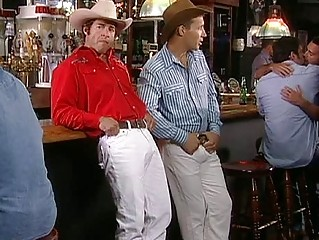 two awesome cowbays drinking beer into a gay